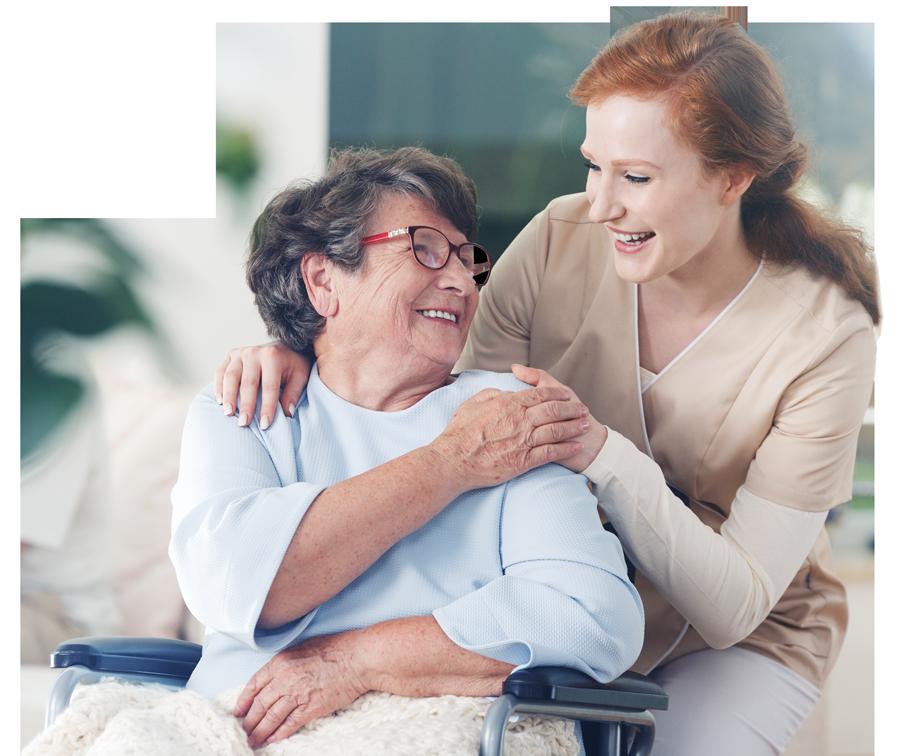 Mayer Ihr Seniorenwohn- und Pflegeheim in Sinn - Bild Frau kümmert sich um eine Dame im Rollstuhl